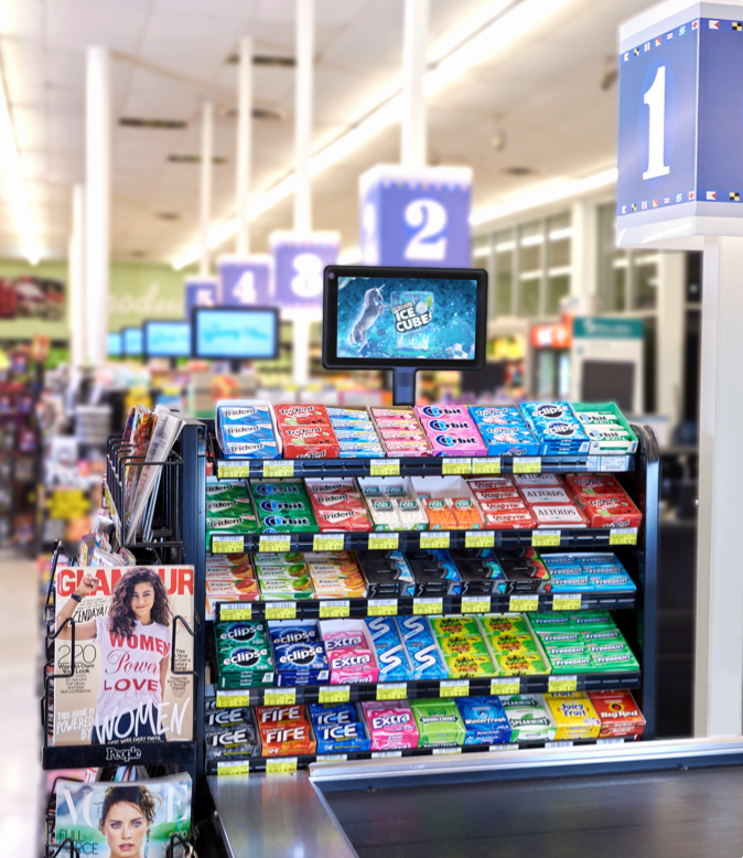 Digital screens in a grocery checkout lane